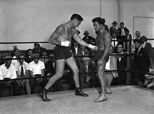 Jim Londos (right) in a ring with professional boxer Jack Dempsey.