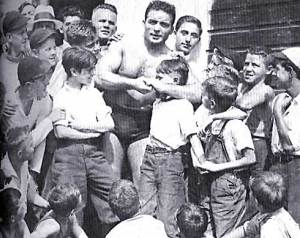 Jim Londos showing a move to his young fans