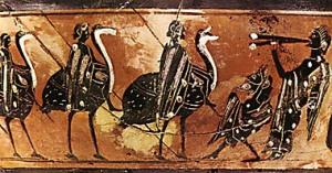Παράσταση χορού νέων αντρών, οι οποίοι ιππεύουν στρουθοκάμηλους, σε μελανόμορφο σκύφο του 6ου αιώνα π.Χ. Δεξιά άντρας παίζει δίαυλο, ενώ μπροστά του η μικρή μορφή του Πανός υποδέχεται το χορό. Boston, Museum of Fine Arts.