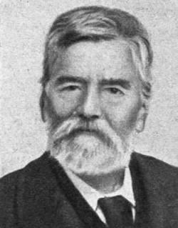 Στέφανος Aθ. Κουμανούδης (1818 - 1899). Η φωτογραφία δημοσιεύεται στο «Ημερολόγιο Σκόκου, 1900», σελίδα, 31.